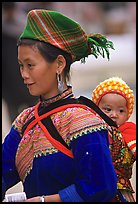Young Flower Hmong woman and baby. Bac Ha, Vietnam