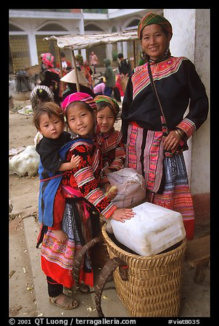 Flower Hmong mother with daughters. Bac Ha, Vietnam (color)