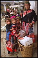 Flower Hmong mother with daughters. Bac Ha, Vietnam