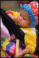 Baby enjoying sugar cane, the natural lollypop,  Bac Ha. Vietnam (color)