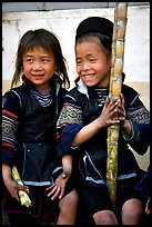 Black Hmong girls, with their daily fix of sugar cane, Sapa. Vietnam ( color)