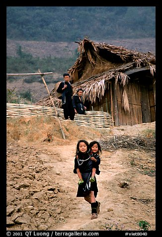 Black Hmong girl and family. Sapa, Vietnam