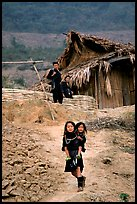 Black Hmong girl and family. Sapa, Vietnam (color)