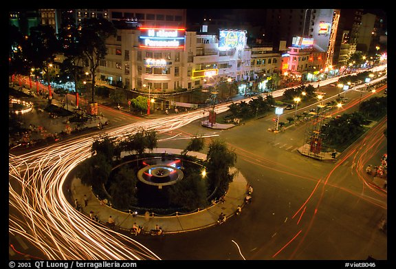 Intersection of Le Loi and Nguyen Hue boulevards at night. Ho Chi Minh City, Vietnam (color)
