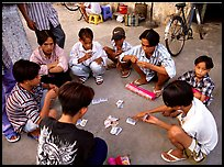 Children playing cards. Ho Chi Minh City, Vietnam