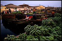 Boats bring loads of produce from the Delta on the Saigon arroyo. Cholon, Ho Chi Minh City, Vietnam (color)