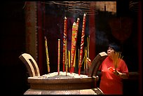 Offering incense at a Chinese temple in Cho Lon. Cholon, District 5, Ho Chi Minh City, Vietnam ( color)