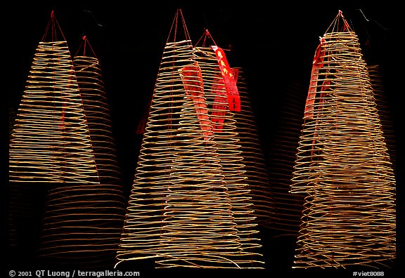 Incense coils  at a Chinese temple in Cho Lon, designed to burn for days. Cholon, District 5, Ho Chi Minh City, Vietnam (color)