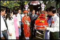 Exchange of gifts at wedding, upon exiting bride's home. The bride traditionaly wears red. Ho Chi Minh City, Vietnam ( color)