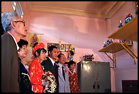 Bride presented to the groom's ancestors in the presence of both parents during a wedding. Ho Chi Minh City, Vietnam (color)