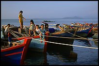 Children play on fishing boats. Vung Tau, Vietnam (color)