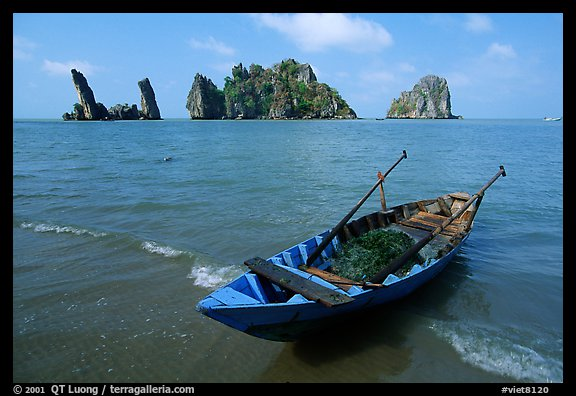 Boat and limestone towers, undeveloped beach. Hong Chong Peninsula, Vietnam (color)