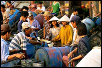 Filling up water tanks for the day. Ha Tien, Vietnam ( color)