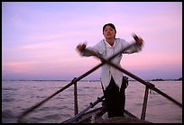 Woman using the X-shaped  paddle characteristic of the Delta. Can Tho, Vietnam (color)