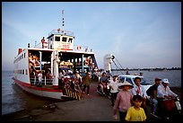 Disembarking from a ferry on one of the many arms of the Mekong, My Tho. Mekong Delta, Vietnam