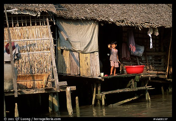 Housing at the edge of the canal, Phung Hiep. Can Tho, Vietnam (color)