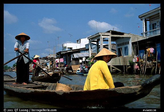 River at the back of townhouses, more used than the road at the front, Phung Hiep. Can Tho, Vietnam (color)