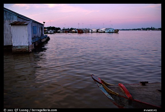 Floating houses. They double as fish reservoirs. Chau Doc, Vietnam (color)