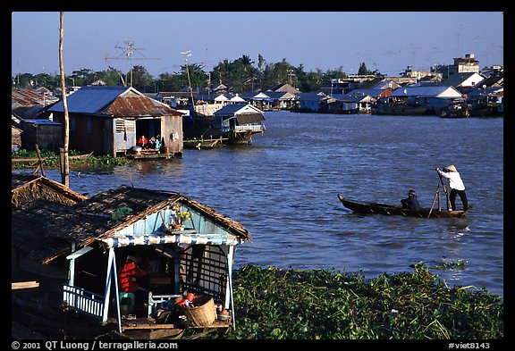 Floating houses on the Hau Gian river. Chau Doc, Vietnam (color)
