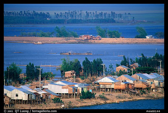 Stilts houses and inundated rice fields. Chau Doc, Vietnam (color)