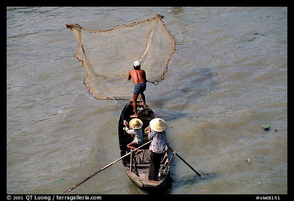 Fisherman casting net seen from above. Can Tho, Vietnam