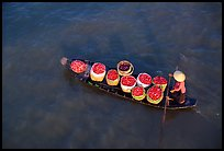 Transporting fruit on a small boat. Can Tho, Vietnam (color)