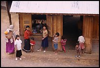 Gathering at the village store, in a minority village. Da Lat, Vietnam ( color)