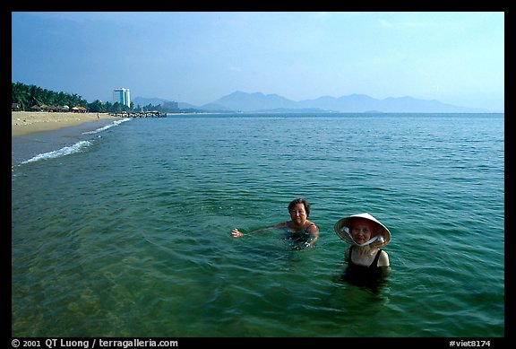 Early morning bath on a perfect beach Nha Trang. Vietnam (color)