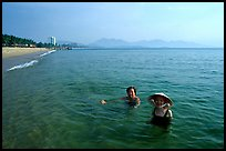 Early morning bath on a perfect beach Nha Trang. Vietnam ( color)