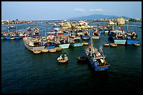 Colorfull fishing boats. Note the circular basket boats used to get to shore.  Nha Trang. Vietnam (color)