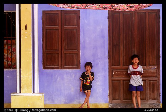 Children in front of old house, Hoi An. Hoi An, Vietnam (color)