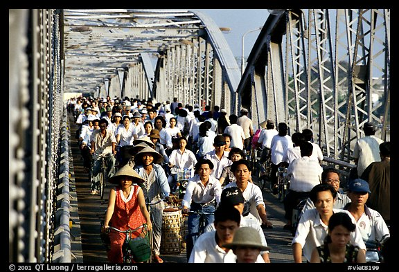 Rush hour on the Trang Tien bridge. The numbers of cars is insignificant compared to Ho Chi Minh city. Hue, Vietnam