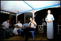 Traditional floating concert on the Perfume river. The city has remained Vietnam's artistic center. Hue, Vietnam (color)