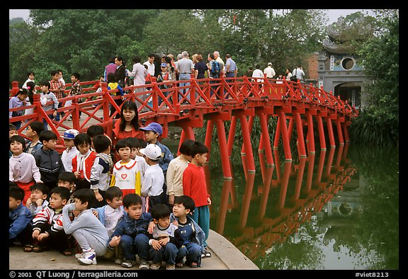 School children at The Huc bridge, Hoan Kiem lake. Hanoi, Vietnam