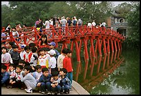 School children at The Huc bridge, Hoan Kiem lake. Hanoi, Vietnam (color)