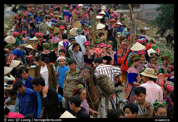 Colorful crowd at the sunday market, where people from the surrounding hamlets gather weekly to meet, shop and eat. Bac Ha, Vietnam (color)
