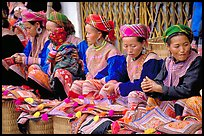 Women sell the colorful garnments after which the Flower Hmong are named. Bac Ha, Vietnam