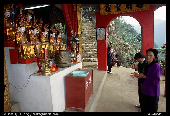 Praying at an outdoor temple. Perfume Pagoda, Vietnam
