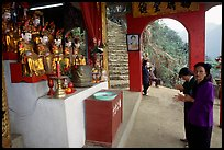 Praying at an outdoor temple. Perfume Pagoda, Vietnam (color)