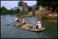 Villagers transport stones from the quary on Ken Ga canal. Ninh Binh,  Vietnam (color)