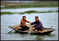 Elderly couple fishing, Ken Ga canal. Ninh Binh,  Vietnam