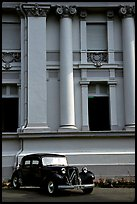 Classic Citroen car in front of city museum. Ho Chi Minh City, Vietnam (color)