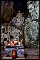 Altar and Buddha statue in a troglodyte sanctuary of the Marble Mountains. Da Nang, Vietnam ( color)