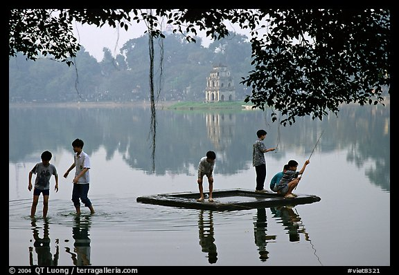 Children playing,  Hoan Kiem Lake. Hanoi, Vietnam