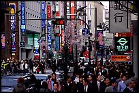 Street in Shinjuku 3-chome looking towards Yotsuya in front of Kinokuniya. Tokyo, Japan ( color)