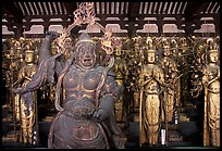 Some of the 1001 statues of the thousand-armed Kannon (buddhist goddess of mercy), Sanjusangen-do Temple. Kyoto, Japan (color)