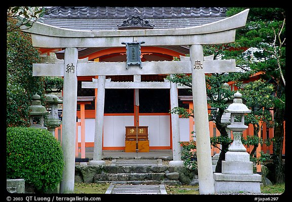 Tori gate at the entrance of a shrine inner grounds. The act of passing through purifies the soul.. Kyoto, Japan (color)
