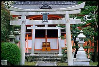 Tori gate at the entrance of a shrine inner grounds. The act of passing through purifies the soul.. Kyoto, Japan ( color)