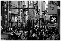Street in Shinjuku 3-chome looking towards Yotsuya in front of Kinokuniya. Tokyo, Japan ( black and white)