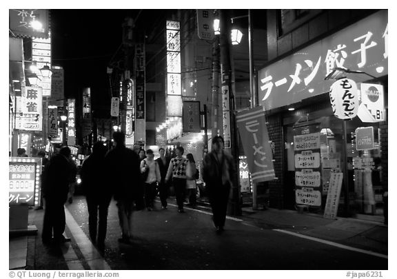 Backstreet by night. Tokyo, Japan (black and white)